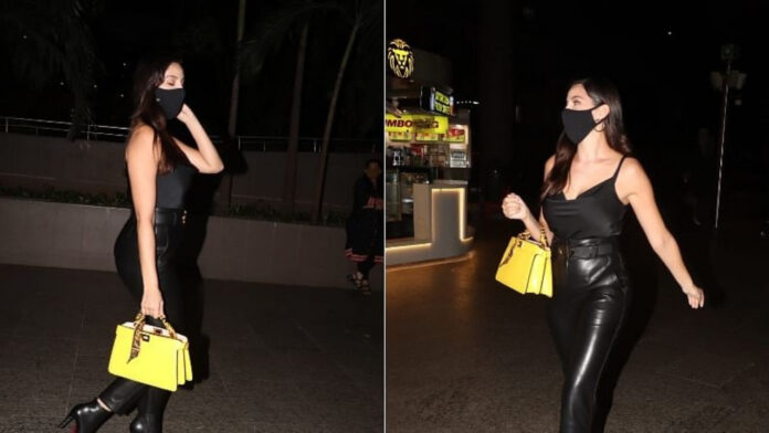 nora fatehi spotted at airport